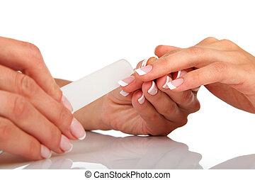 Manicure - Woman in a nail salon receiving a manicure