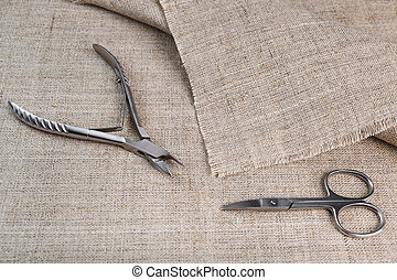 manicure tools on the background of linen cloth