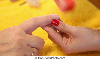 Manicure. - Visagist making manicure to a model. Close-up.