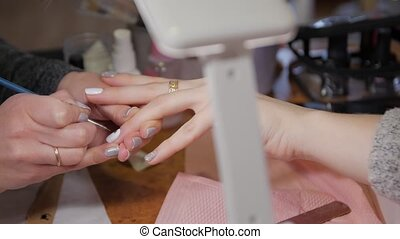 Manicure with a pattern drawing closeup