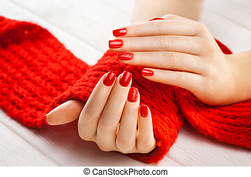 manicure with a red knitted scarf