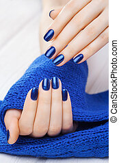 manicure with blue knitted scarf