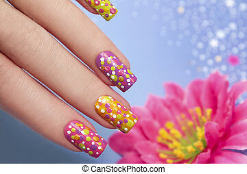 Manicure with points. - Manicure with multi-colored varnish...