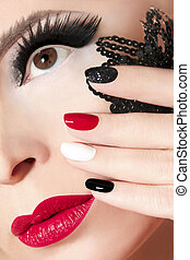 Manicure with red lips.