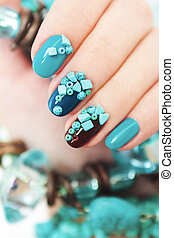 Manicure with turquoise.