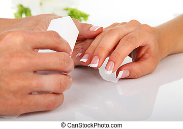 Manicure - Woman in a nail salon receiving a manicure