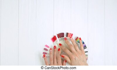 Manicured hands and nail color palette. Young woman hands...