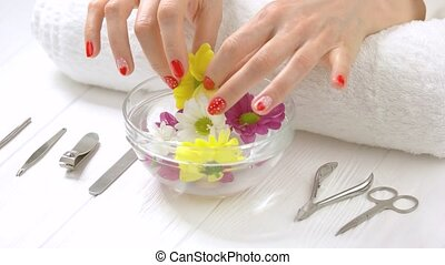 Manicured hands receiving spa procedure. Beautiful woman...