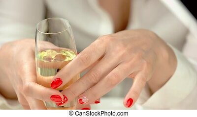 Manicured hands with glass of champagne. Well-groomed hands...