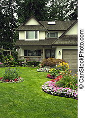 Manicured Home and Yard - A well kept home with a colourful ...