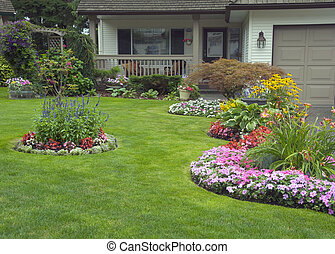 A well kept home with a colourful perennial and annual garden