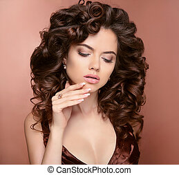 Manicured nails. Hair. Beautiful Brunette Girl Model  with shiny curly silky hairstyle and makeup. Brown.