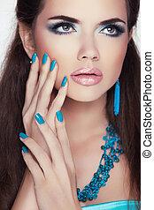 Manicured nails. Makeup. Beauty Fashion Brunette Woman Portrait.Trendy Fashion Jewelry