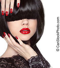 Manicured nails. Red lips. Black bob hairstyle. Brunette...