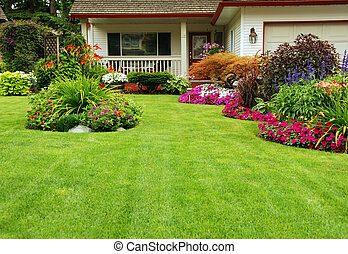 Manicured Yard - A finely manicured yard show its summer/...
