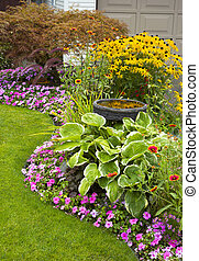 Manicured Yard - A beautifully manicured yard with a garden...