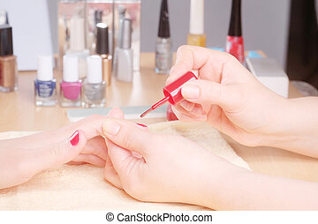 Manicurist doing manicure
