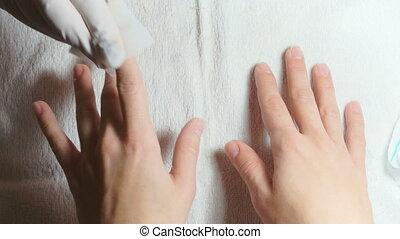 Manicurist uses professional manicure tool.