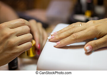 Manicurist work process with copy space. Close up view of female nail painting.