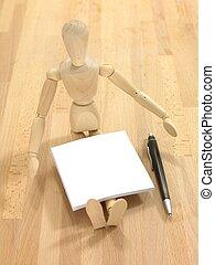 Manikin - A wooden manikin isolated on a wooden floor
