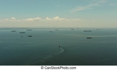 Manila bay with ships aerial view. - Cargo vessels in Manila...