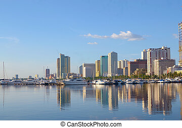 manila city scape - manila bay city scape with yachts and ...