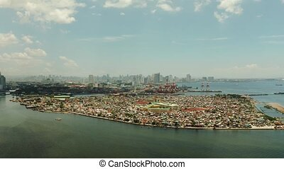 Manila city with skyscrapers, Philippines aerial view. -...