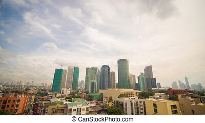 Manila skyscrapers in the cloudy evening. Makati District....