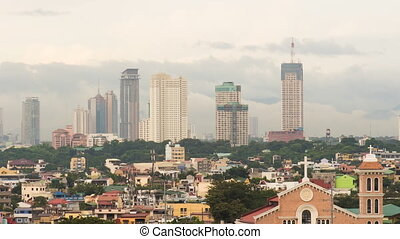 Manila skyscrapers in the cloudy evening. Philippines.
