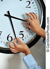 Manipulating time - Business man hands manipulating hands of...