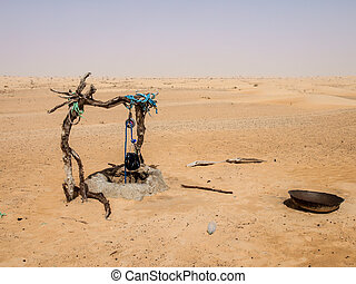 Manmade drinking well with rope and bucket in Sahara Desert