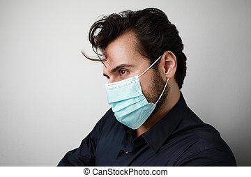 mann, aside., covid-19., schauen, steht, situation, maske, headshot, medizin, hintergrund, junger, weißes, pandemisch