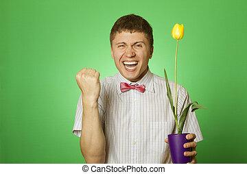 mann, besitz, a, gelbe tulpe