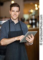 mann, eigentümer, besitz, digital tablette, in, cafeteria