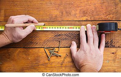 mann, hand, messen, hölzerner stock