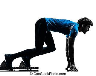 mann, läufer, sprinter, auf, anfangende blöcke, silhouette