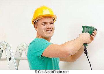 mann, mit, elektrische bohrmaschine, machen, loch, in, wand