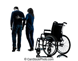 mann, mit, frau laufen, weg, von, rollstuhl, silhouette