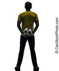 mann, silhouette, fußball, zurück, besitz, fußball, hintere ansicht