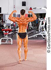 mannelijke , bodybuilder, het poseren, in, gym