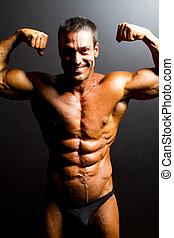 mannelijke , bodybuilder, het poseren, op, black