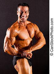mannelijke , bodybuilder, op, zwarte achtergrond