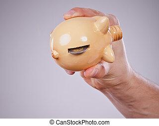 mannelijke , hand, met, muntjes, en, piggybank