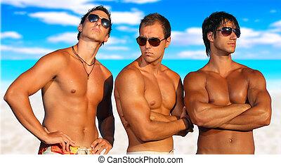 mannen, relaxen, op het strand