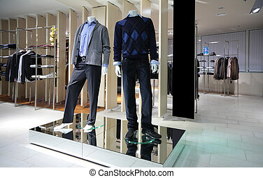 Manneqiuns in section of men clothes in shop