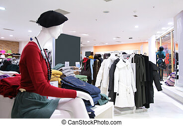 mannequin and upper clothes in shop. focus on middle plan