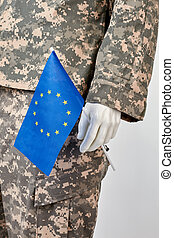 Mannequin in army uniform holds european flag.