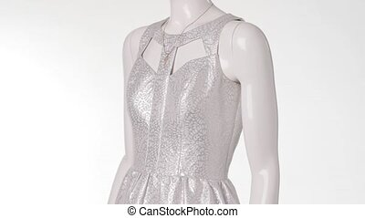 Mannequin in cutout dress turning. Cutout dress and key...