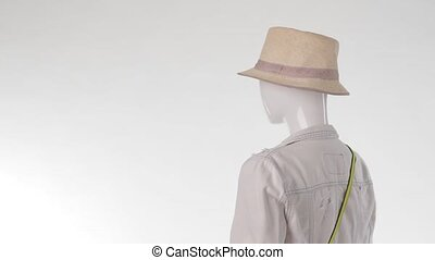Mannequin in denim jacket turning. Lady's short denim...