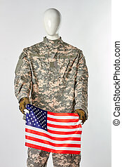 Mannequin in military army uniform holding american flag.
